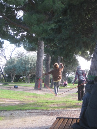 Slacklining (walking on a rope between two trees)